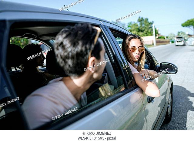 Friends in car seen from outside