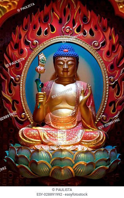 colorful statue of buddha sitting on lotus