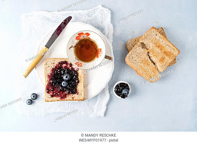Toast with blueberry jam and cup of tea