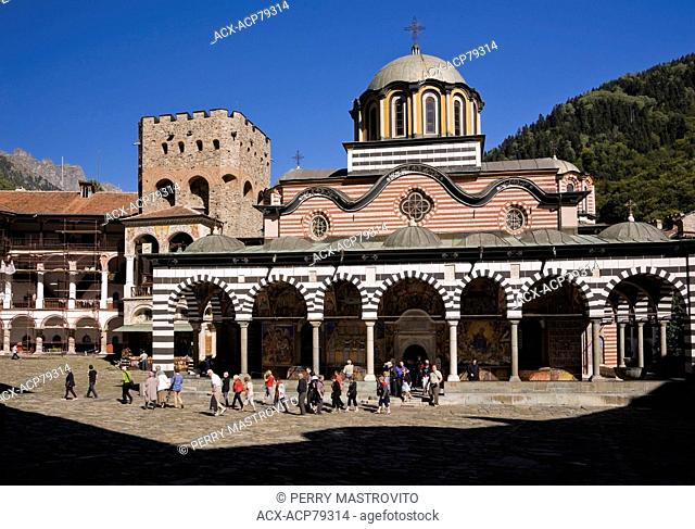 Tourists in front of the Nativity Church at the Rila Monastery, Rila, Bulgaria, Eastern Europe