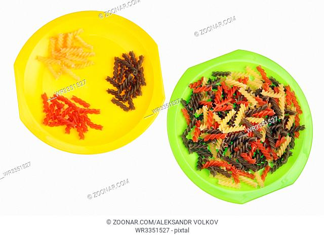 Sorts of dry colored Italian spiral pasta concept. Isolated on white top view studio shot