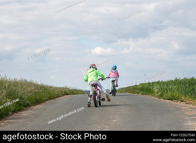 Bamberg, Germany May 26th, 2020: Symbolic images - 2020 child is riding a bicycle / child is wearing a helmet while cycling / child is riding a bicycle on the...