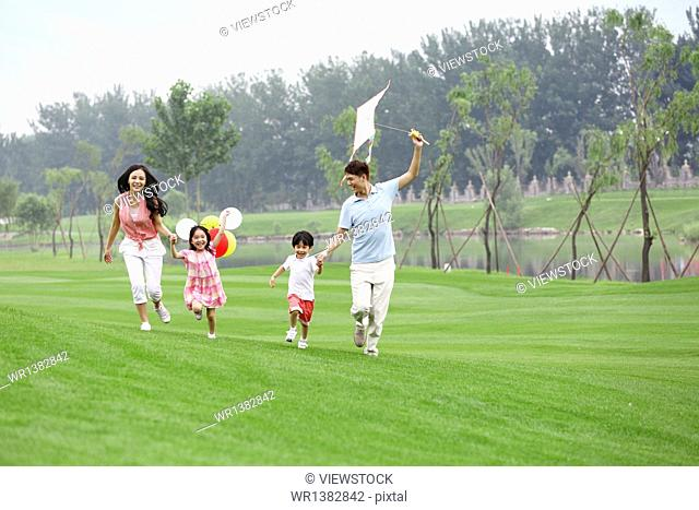 Happy family playing in the outskirts