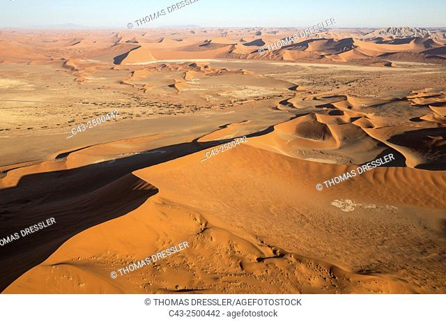 Sand dunes in the Namib Desert. Top right the Witberg (White Mountain, 426m), a granite massif in the centre of the Namib Desert