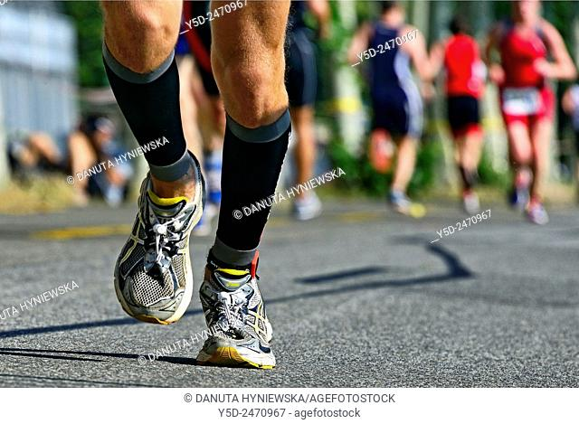 legs of male athlete running