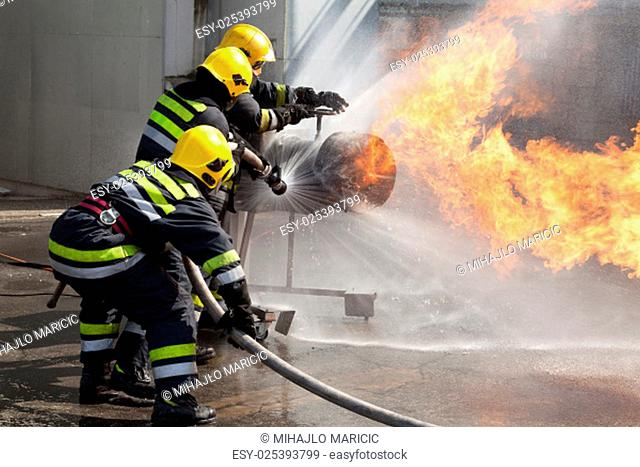 Firefighters attack a propane fire during a training exercise