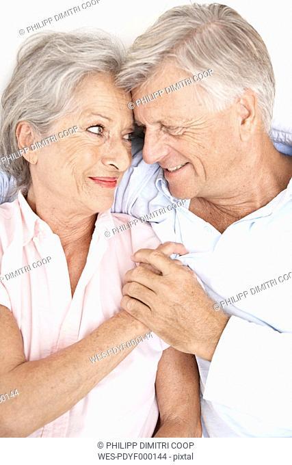 Spain, Senior couple relaxing in hotel, smiling