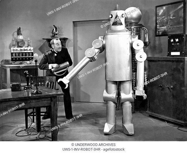 Hollywood, California: 1934.A robot and its inventor featured in the Universal film, The Vanishing Shadow
