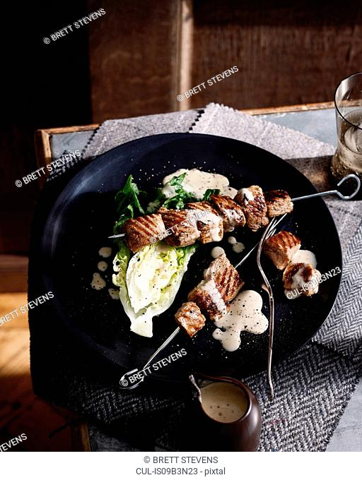 Pork kebab with chicory and creamy dressing