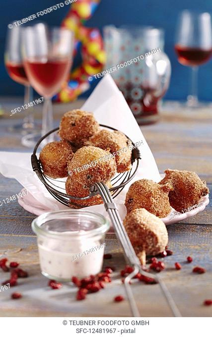 Sweet, deep-fried quark balls with lingonberry yoghurt dip
