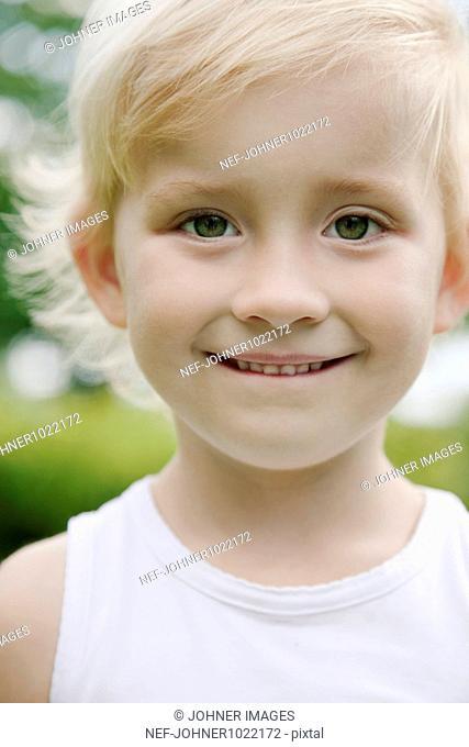 Sweden, Stockholm, portrait of blonde girl smiling