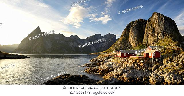 Norway, Nordland, Lofoten islands, Moskenesoy island, the fishing village of Hamnoy, traditional fishermen cabins built on stilts (rorbu, rorbuer) at sunset