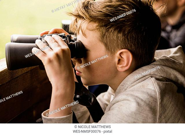 Boy birdwatching with binoculars