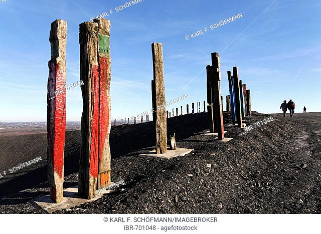Totems art installation by Basque artist Agustin Ibarrola, painted railway ties at the top of the Haniel spoil pile, Bottrop, North Rhine-Westphalia, Germany