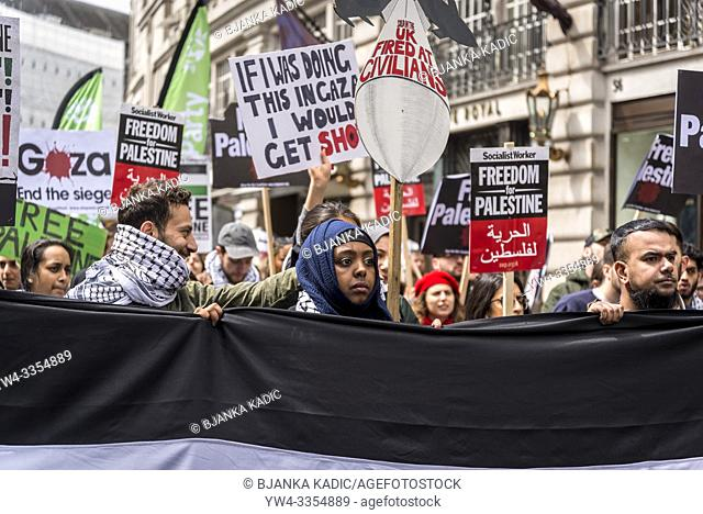 National Demonstration for Palestine, Young Black Muslim woman behind the banner, London, UK 11/05/2019