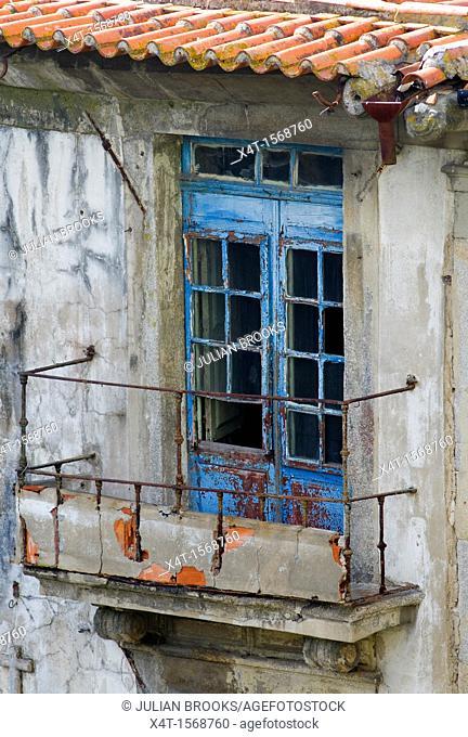 A run down balcony in need of renovation  Porto, Portugal