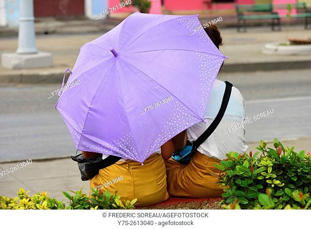 Two student under umbrella in Cienfuegos, Cuba
