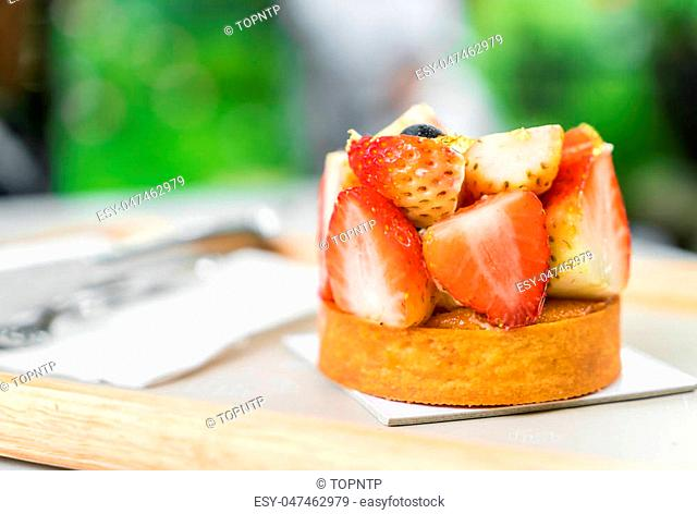 close-up strawberry tart dessert on wood tray