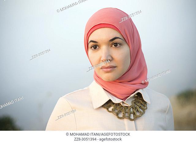 Beautiful Muslim woman looking away outdoors