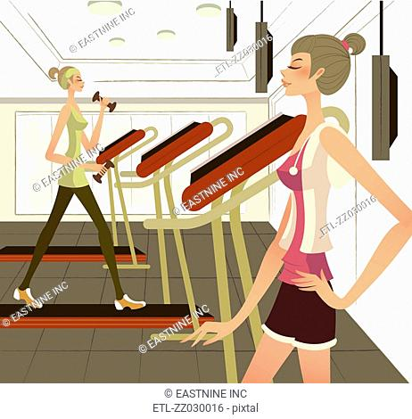 Side profile of a woman standing with her hand on her hip with another woman exercising on a treadmill