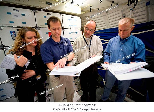 Canadian Space Agency astronaut Julie Payette, STS-127 mission specialist; along with NASA astronauts Tom Marshburn (second left)