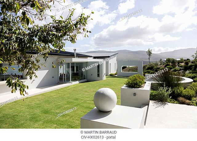 Sunny modern luxury home showcase exterior and yard