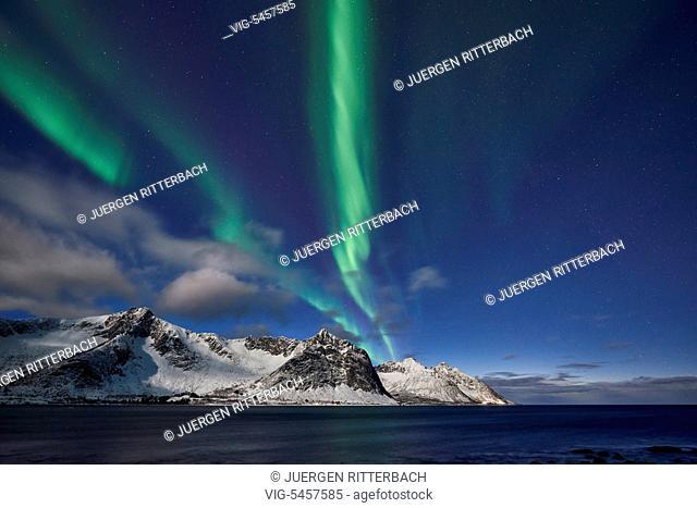 NORWAY, SENJAHOPEN, 19.02.2016, Aurora Borealis or northern lights over winter landscape in fjord of Ersfjorden, Senja, Troms, Norway, Europe - Senjahopen