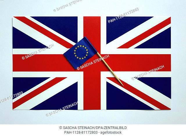 ILLUSTRATION -A small European flag is seen on a British flag, 02 June 2016. Britons will vote on whether to remain in or leave the EU in a referendum on 23...