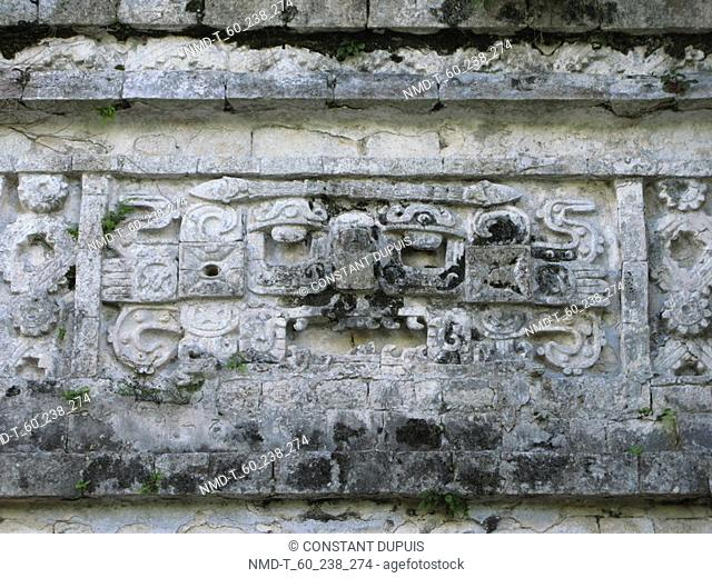Carving on a stone wall, Nunnery Quadrangle, Yucatan, Mexico