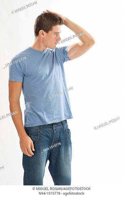 Photo of American plans for a teenage boy standing with hand in hair