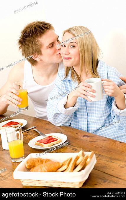 Breakfast happy couple enjoy romantic kiss