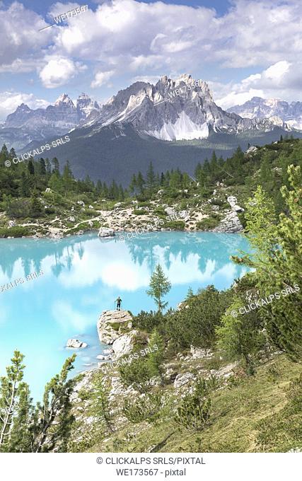 Man standing at Lake Sorapiss, Sorapiss Lake, Dolomites, Veneto, Italy