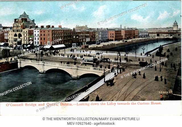O'Connell Bridge & Quays, Dublin, County Dublin, Republic of Ireland. View looking down the Liffey to Custom House