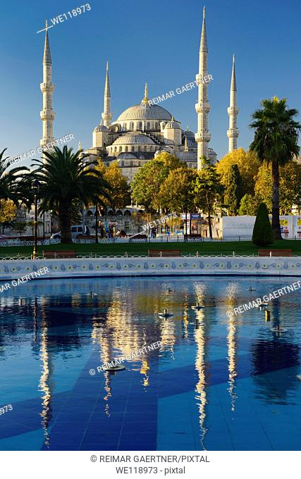 Blue Mosque in early morning sun with reflection in pool Istanbul Turkey