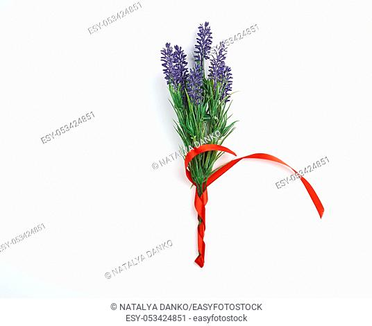 lavender bouquet and red ribbon on a white background, top view, copy space