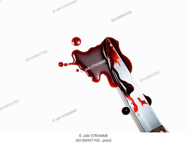 Blood spattered kinfe against white background
