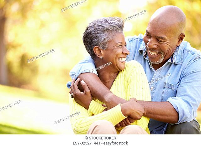 Senior Couple Relaxing In Autumn Landscape