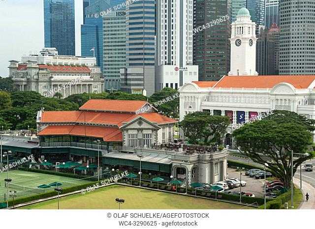 Singapore, Republic of Singapore, Asia - View of the Victoria Theatre, the Singapore Cricket Club and the central business district around Raffles Place