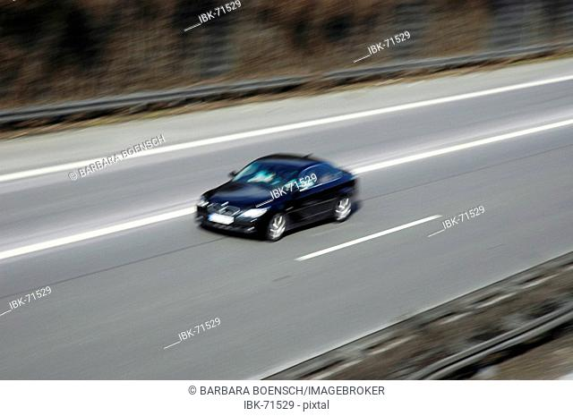 Fast driving car on the autobahn, speed, traffic
