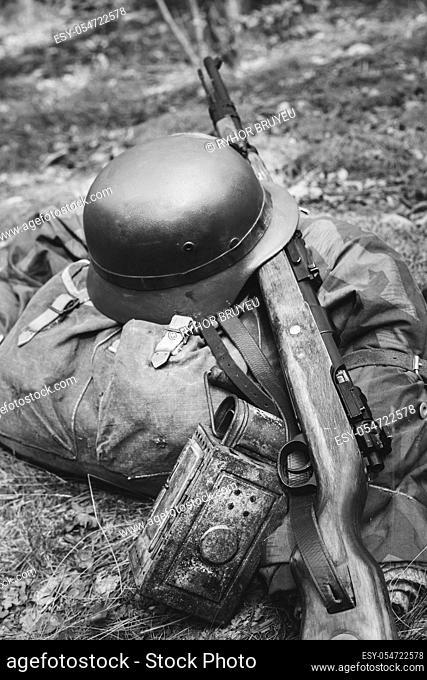 World War II German Wehrmacht Soldier Ammunition Of World War II On Ground. WWII Military Helmet, Lights, Rifle Mauser Karabiner 98K