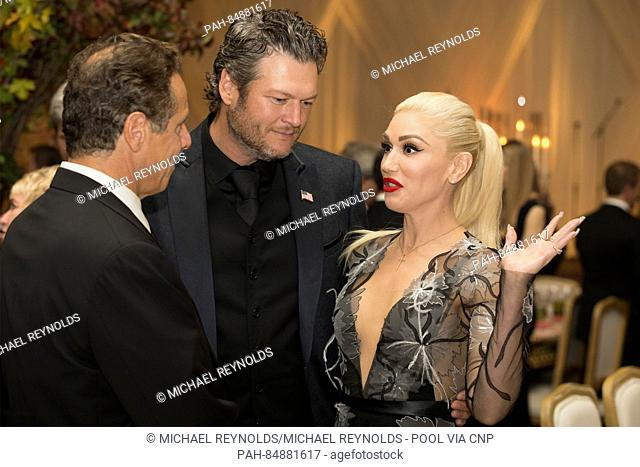 US entertainer Gwen Stefani (R), US entertainer Blake Shelton (C) and New York Governor Andrew Cuomo (L) attend a state dinner for Italian Prime Minister Matteo...
