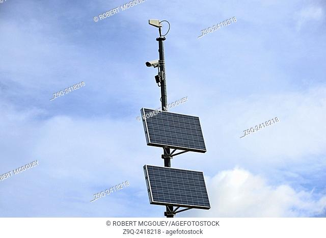 A remote highway camera with solar pannel operating system against a sky background in rural Alberta. Canada