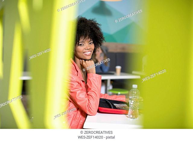 Portrait of smiling woman in office lounge