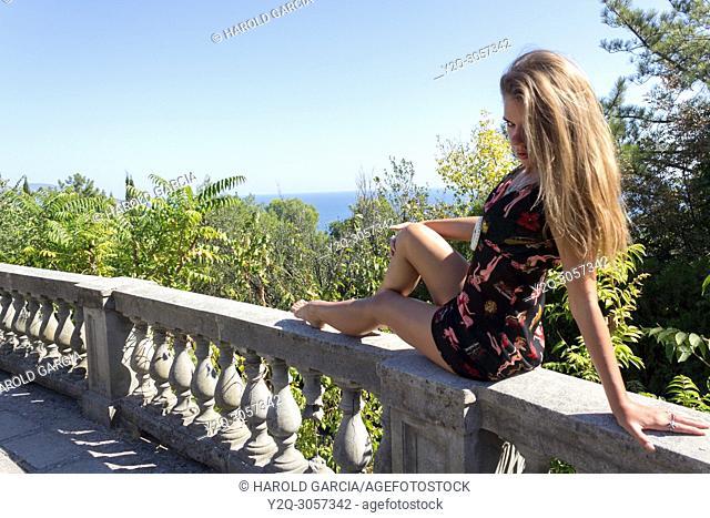 Beautiful woman posing for the camera in Livadia Palace in Alupka, Crimea