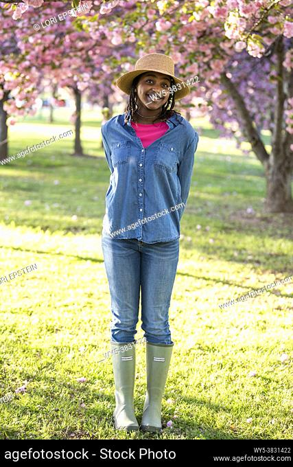 A Black teenage girl poses for the camera