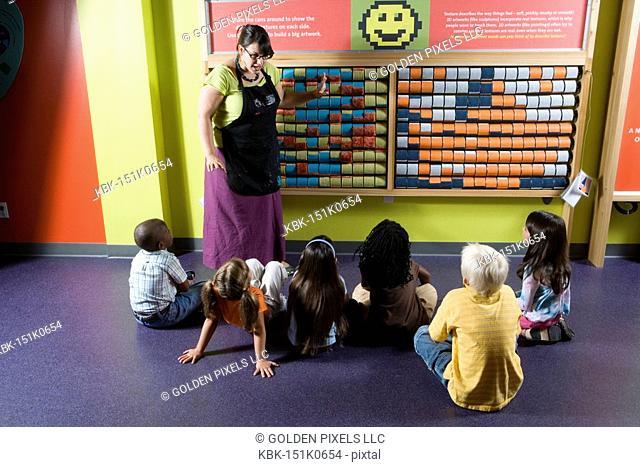 Teacher shows children an interactive art display