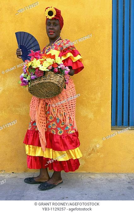 Cuban woman in traditional dress, Plaza de la Catedral, Habana, Cuba