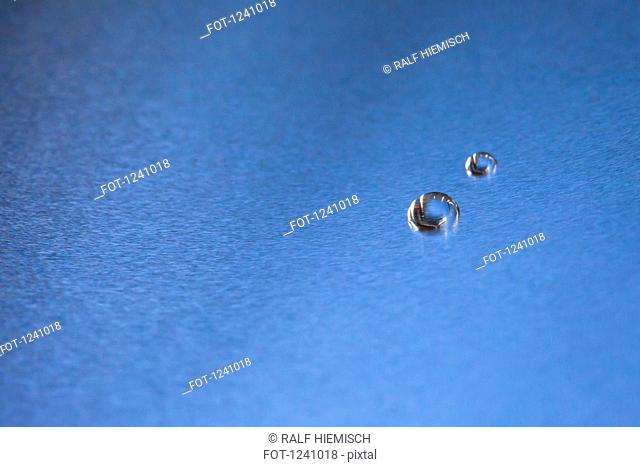 Two water drops on a blue background