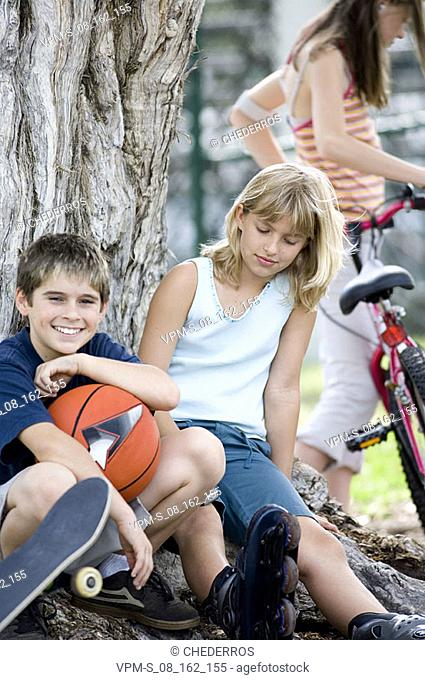 Boy and a teenage girl sitting together
