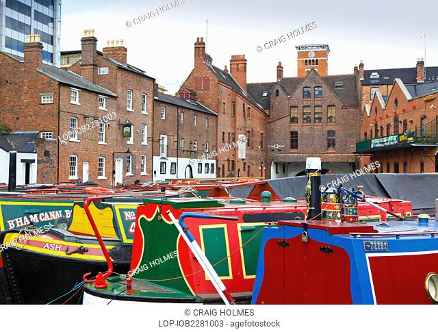 England, West Midlands, Birmingham. Colourful barges in Gas Street Basin at the hub of the canal network in Birmingham